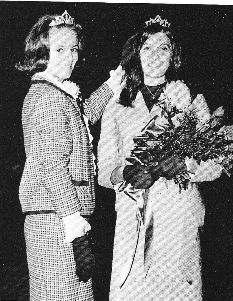 The 1967 Homecoming Queen, Nancy Bently, crowns the 1968 Queen, Donna Bales