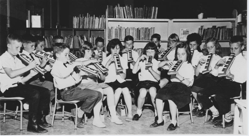 Music Class at WZES directed by John T.V. Clark in 1967. These are students from ZHS class of 1973 and are: Back row - Johnny Ray White, Vickie Griffin, Suzie Hill, James Meyer, Dale Reutimann, Steve Massey, Robbie Kretschmar, Richard Risher. Front Row - Rhonda Duncan, Connie Geiger, Linda McAdams, Jason Osborne, Tommy Garland, Debbie Messer, Nancy Clark, Mark Coyne, Dale Myers.