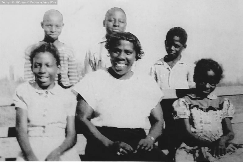 Front row: Mrs. Bessie Barefield, Teacher/Principal, Mary Etta Holmes, Wila Blue, Nancy Jones, Mary Alice Stewart; Second Row: Lonnie Turner, Bessie Mae Giles, Matie Holmes